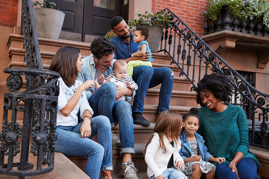 family on stoop in city